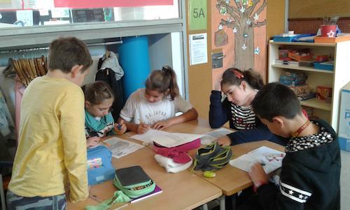 Cueme Nens treballant